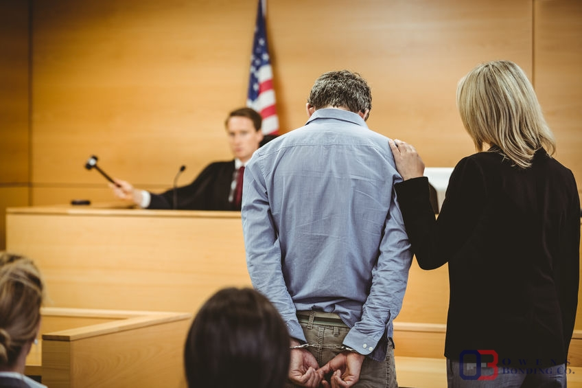 Man in Handcuffs Bows Head in Courtroom